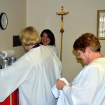Eucharistic Ministers at work